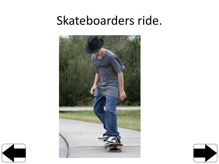 Skateboarders ride
