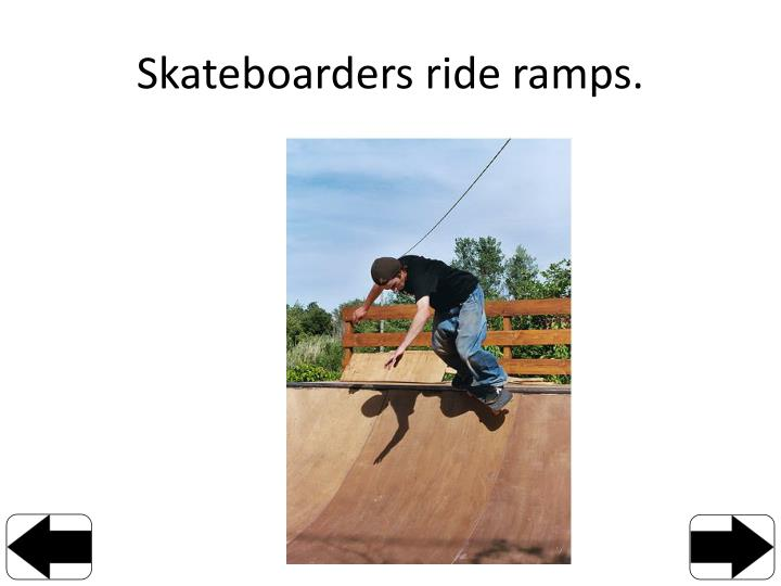 Skateboarders ride ramps.