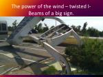 the power of the wind twisted i beams of a big sign