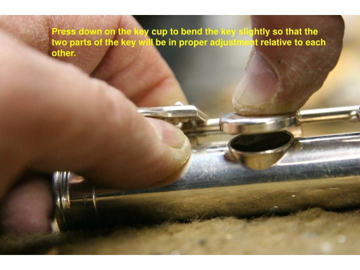 Press down on the key cup to bend the key slightly so that the