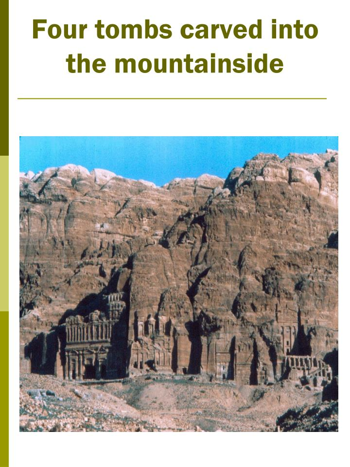 Four tombs carved into the mountainside