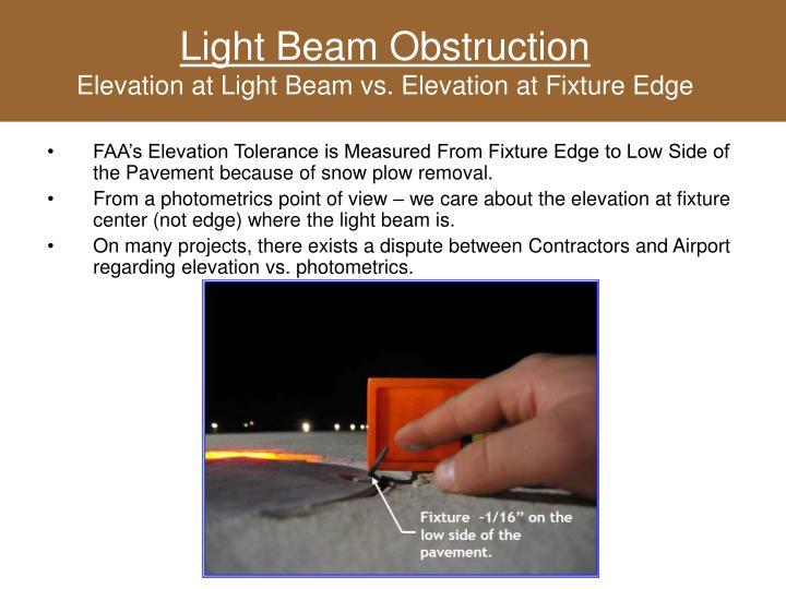 Light beam obstruction elevation at light beam vs elevation at fixture edge