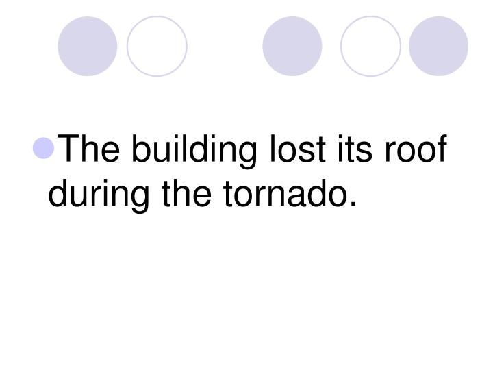 The building lost its roof during the tornado.