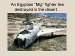 an egyptian mig fighter lies destroyed in the desert