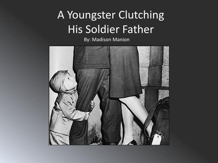 a youngster c lutching his s oldier father n.