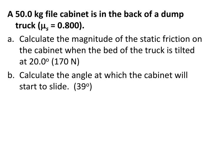 A 50.0 kg file cabinet is in the back of a dump truck (