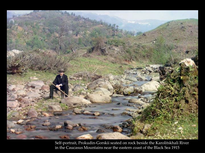 Self-portrait, Prokudin-Gorskii seated on rock beside the Karolitskhali River in the Caucasus Mounta...