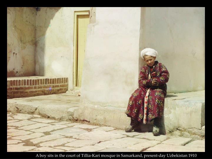 A boy sits in the court of Tillia-Kari mosque in Samarkand, present-day Uzbekistan 1910