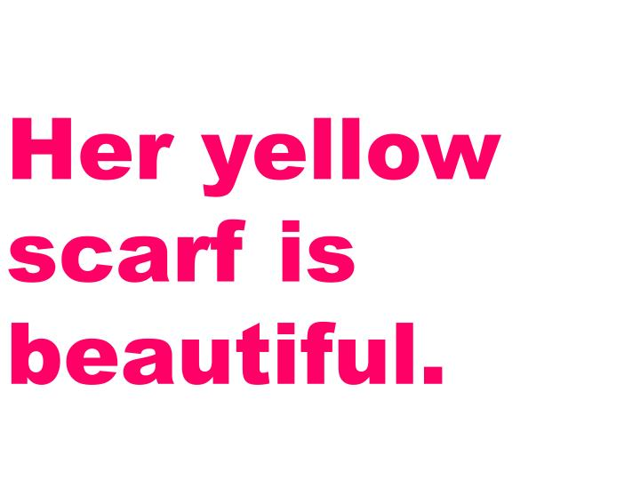 Her yellow scarf is beautiful.