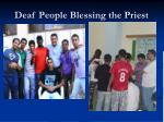 deaf people blessing the priest