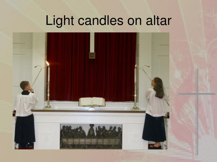Light candles on altar