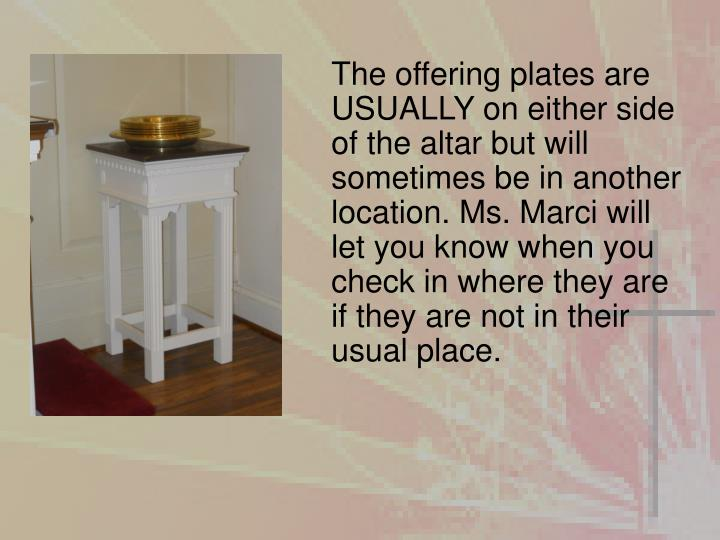 The offering plates are USUALLY on either side of the altar