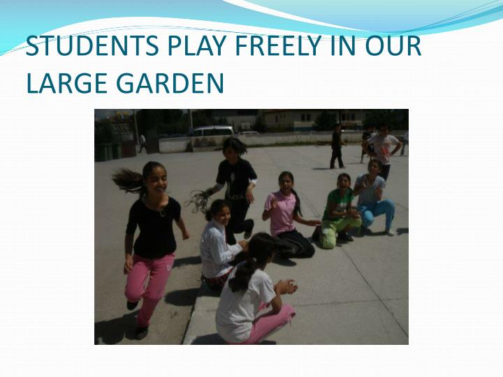 STUDENTS PLAY FREELY IN OUR LARGE GARDEN