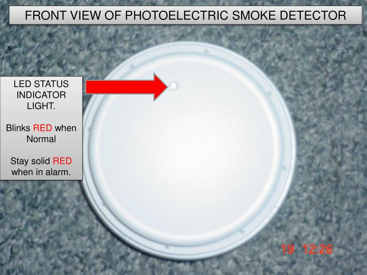 how does a photoelectric smoke detector work n.