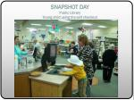 snapshot day public library young child using the self checkout