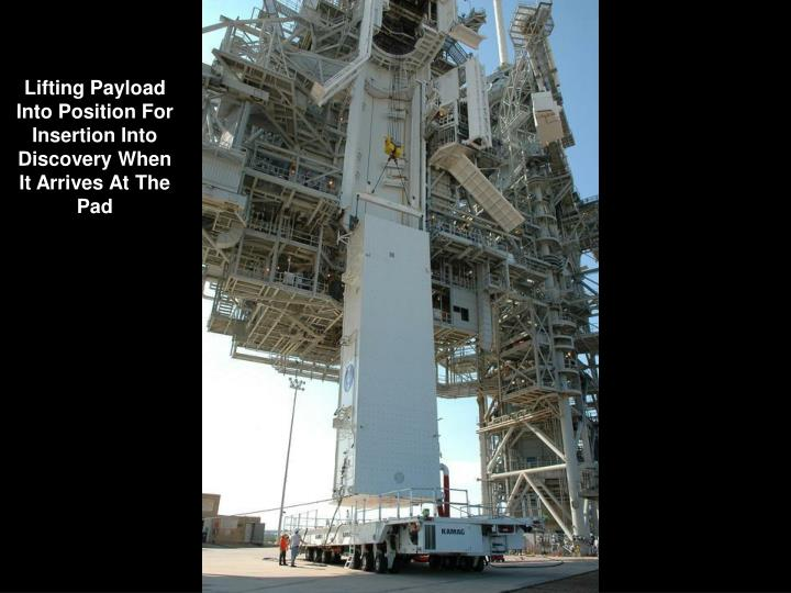 Lifting Payload   Into Position For  Insertion Into  Discovery When  It Arrives At The Pad