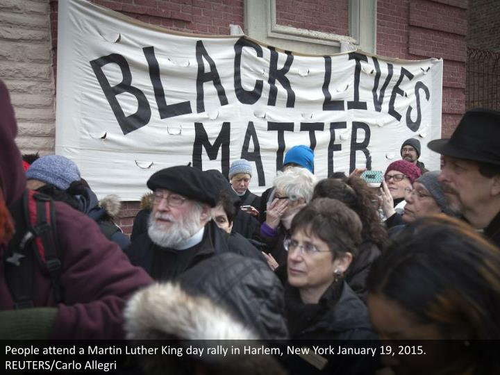 People attend a Martin Luther King day rally in Harlem, New York January 19, 2015. REUTERS/Carlo Allegri