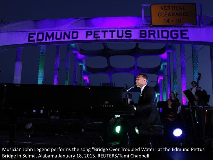 "Musician John Legend performs the song ""Bridge Over Troubled Water"" at the Edmund Pettus Bridge in Selma, Alabama January 18, 2015. REUTERS/Tami Chappell"