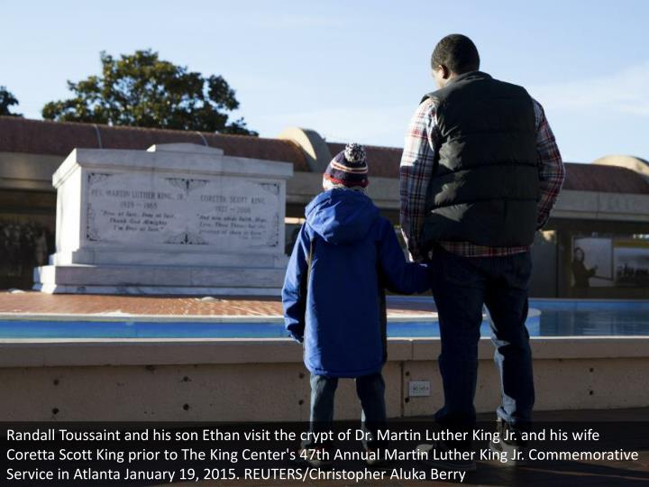 Randall Toussaint and his son Ethan visit the crypt of Dr. Martin Luther King Jr. and his wife Coretta Scott King prior to The King Center's 47th Annual Martin Luther King Jr. Commemorative Service in Atlanta January 19, 2015. REUTERS/Christopher Aluka Berry