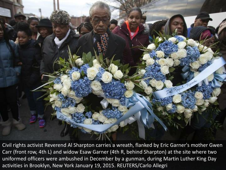 Civil rights activist Reverend Al Sharpton carries a wreath, flanked by Eric Garner's mother Gwen Carr (front row, 4th L) and widow Esaw Garner (4th R, behind Sharpton) at the site where two uniformed officers were ambushed in December by a gunman, during Martin Luther King Day activities in Brooklyn, New York January 19, 2015. REUTERS/Carlo Allegri